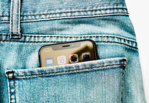 New Apple iPhone X smartphone in jeans denim pocket