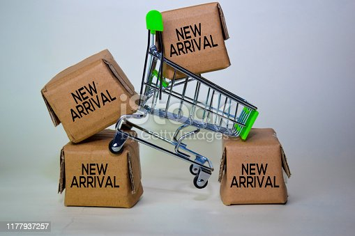 New Arrival Text in small boxes and shopping cart. Concepts about online shopping. Isolated on white background