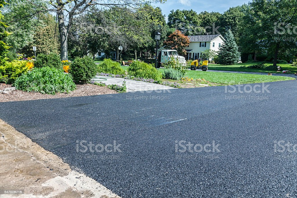 New Asphalt Driveway at Suburban Residential Home stock photo