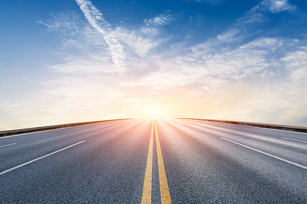 new asphalt highway scenery at sunset - diminishing perspective stock photos and pictures
