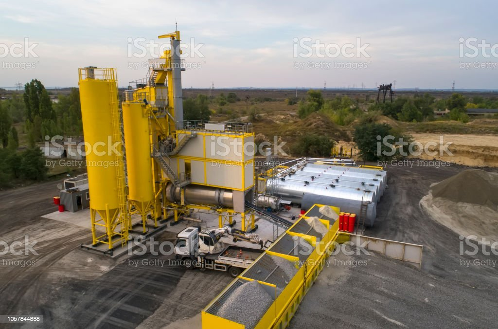 New asphalt plant. Aerial drone footage. Asphalt mix is used for the construction of roads, pavements and parking lots. stock photo