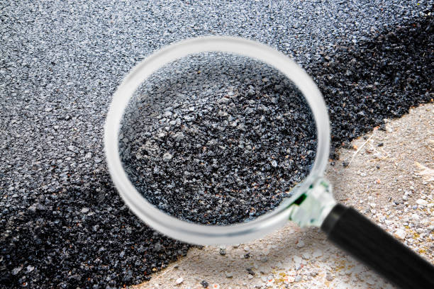 New asphalt road background - Concept image seen through a magnifying glass stock photo
