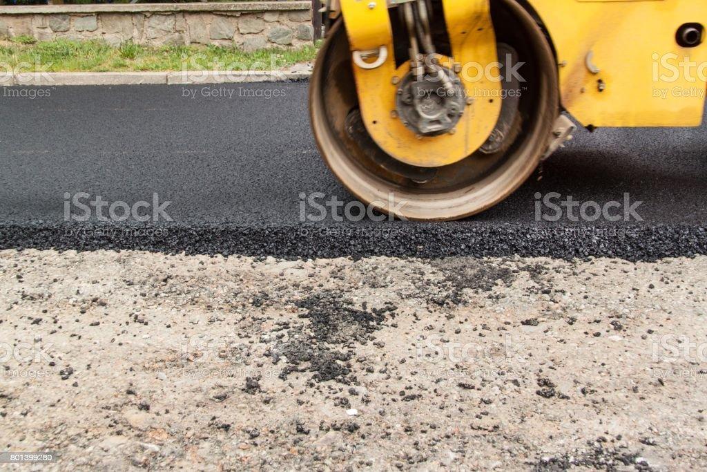 New asphalt road. Road asphalt works. Construction works. stock photo
