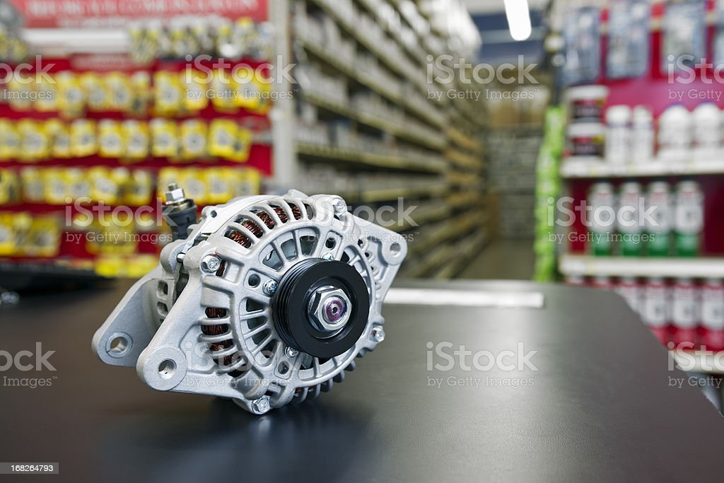 New automotive alternator in a parts department. stock photo
