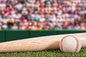 A new baseball and bat with stadium and crowd background