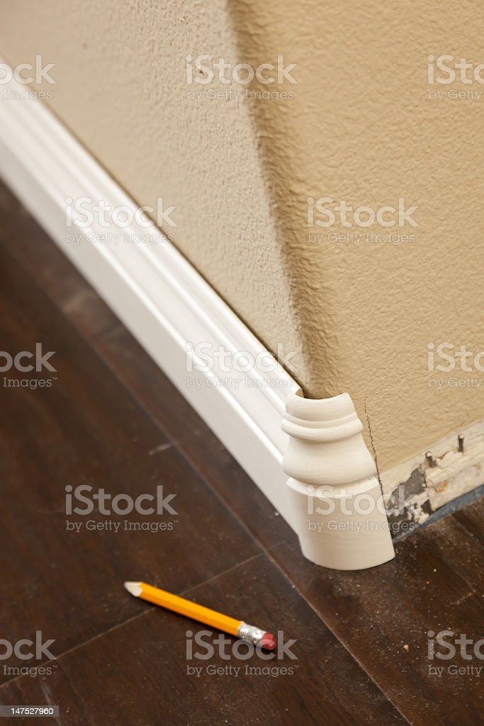 New Baseboard And Bull Nose Corners With Laminate Flooring Stock