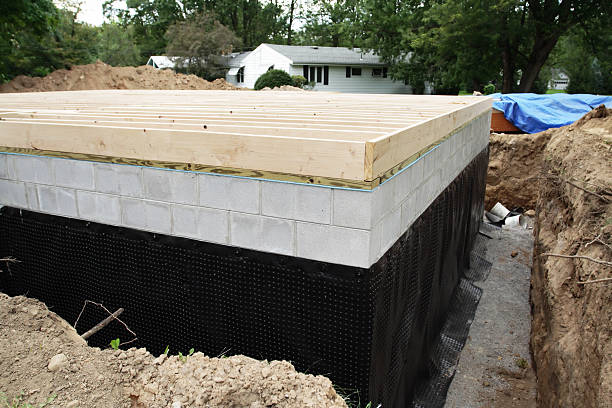 new basement foundation waterproofing - stability stock photos and pictures