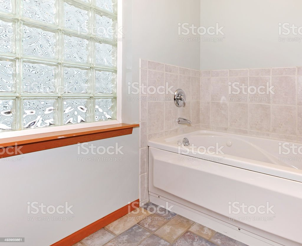 New Bathroom Corner With Glass Block Window And Tub Stock Photo ...