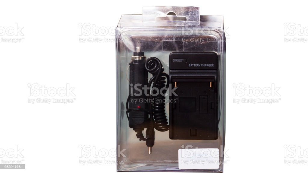 New battery charger in a clear plastic package, Ready for AC line and in car usage. stock photo