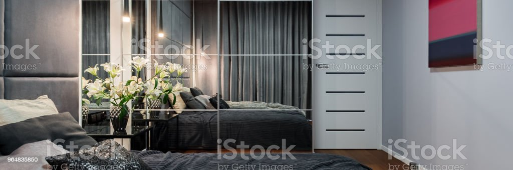 New bedroom with mirrored wardrobe royalty-free stock photo
