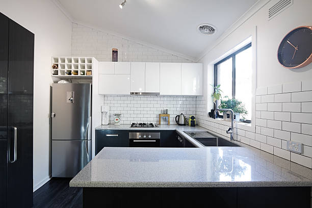 New black and white contemporary kitchen with subway tiles stock photo