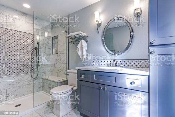 New blue bathroom design with marble shower surround picture id950319064?b=1&k=6&m=950319064&s=612x612&h=7oo9tealff3c fkbmosbv8cttri7ufkefmroynlazmu=