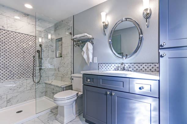 New blue bathroom design with Marble shower Surround stock photo