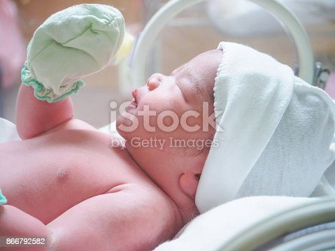 new born baby infant sleep in the incubator at hospital