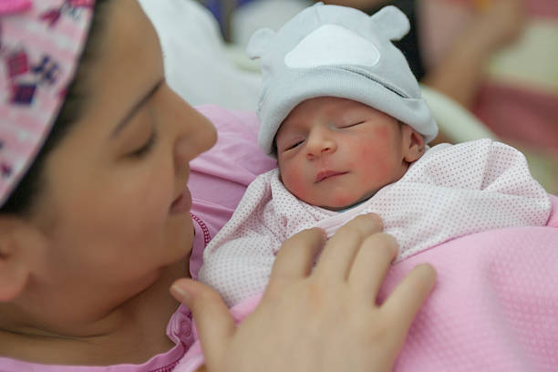 New born baby with his mother stock photo