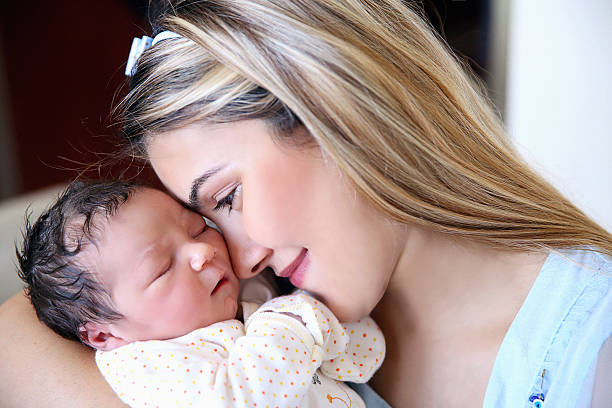 new born baby with his mother - c section stock photos and pictures