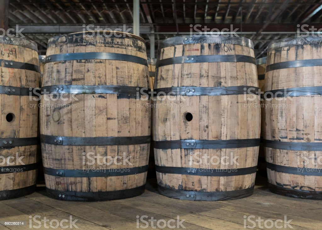 New Bourbon Barrels to be Filled stock photo
