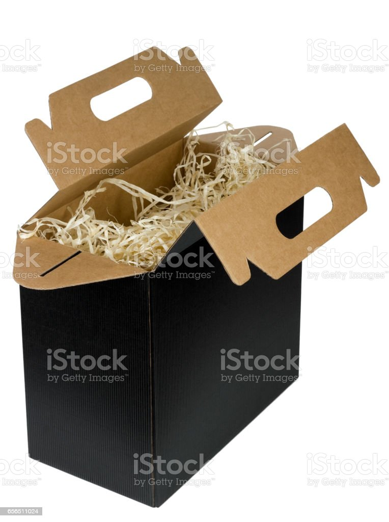 New box of black  loose corrugated cardboard for wine bottles isolated. Inside the box is soft straw and shavings.  Mass prodiction stock photo