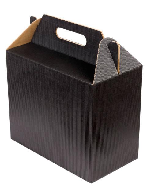new box of dark loose corrugated cardboard for wine bottles isolated. mass prodiction, selective focus - wine box bildbanksfoton och bilder