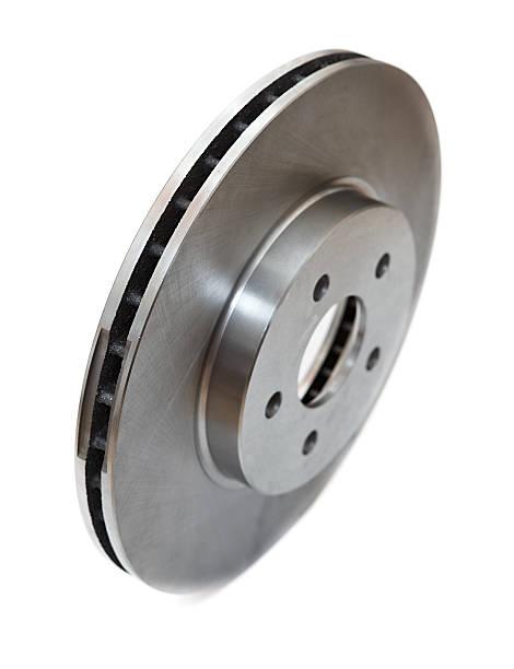 nouveau disque de frein isolé sur blanc - disque de frein photos et images de collection