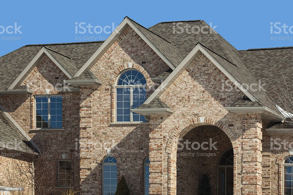 New Brick Mansion Home, Gabled Architectural Asphalt Roof, Half-Round Windows stock photo