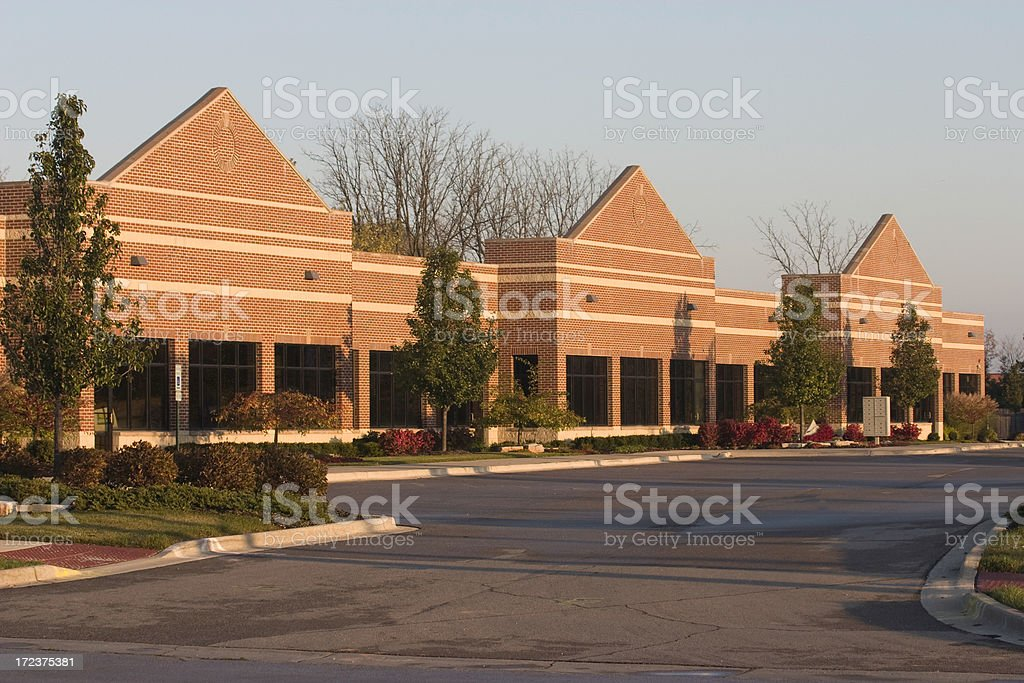 new brick strip mall stock photo