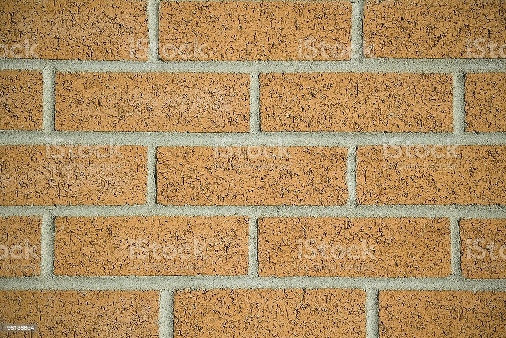 New brick work. Orange backdrop royalty-free stock photo