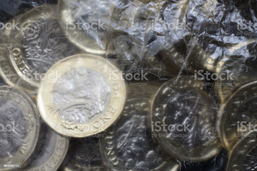 New British one pound coins 2017 in plastic bag stock photo