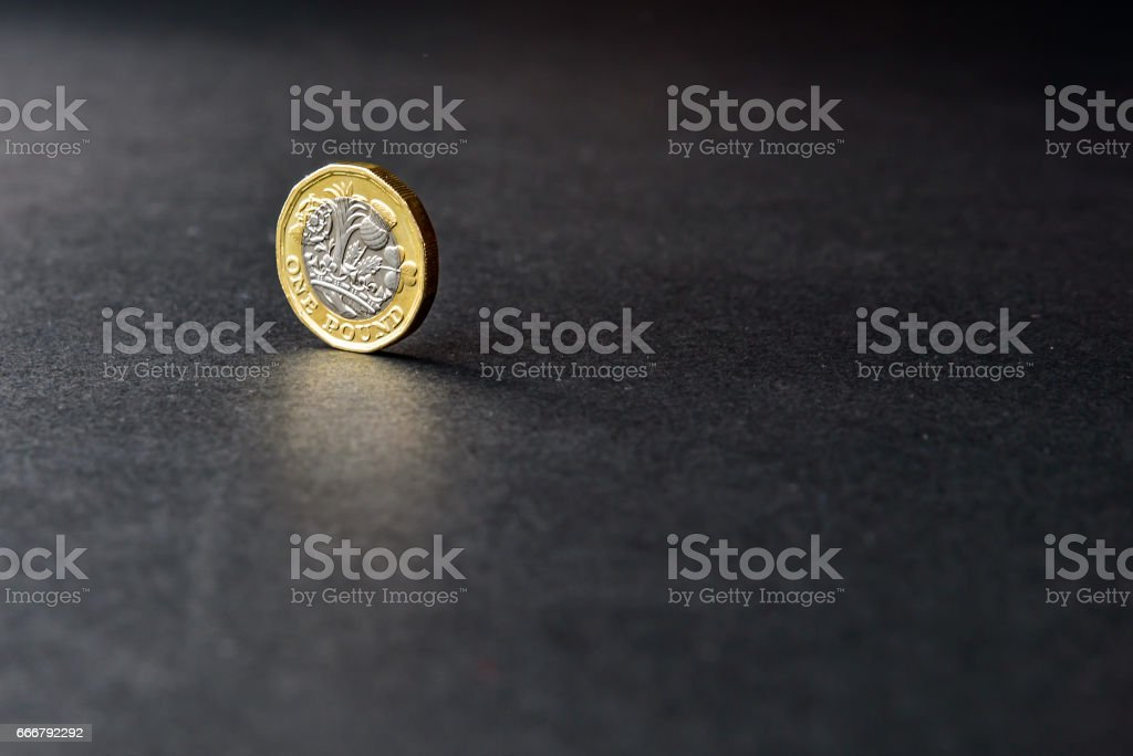 New british one sterling pound coin on dark background stock photo