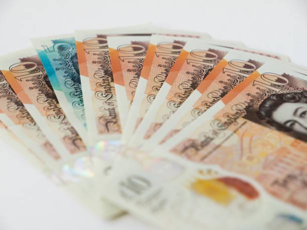 New british ten pound notes in a fan shape with a single new five picture id917873980?b=1&k=6&m=917873980&s=612x612&w=0&h=qstknmcpillhv2gkiatdmo4e3fnayqfh7diirnokp6e=
