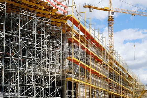 istock new building construction site,  scaffolding and crane on building site 910215238