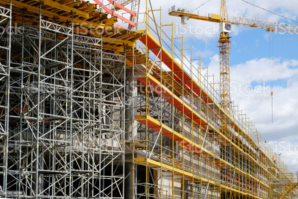new building construction site,  scaffolding and crane on building site stock photo