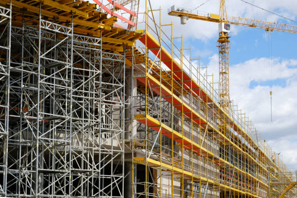 new building construction site,  scaffolding and crane on building site new building construction site - scaffolding and crane on building site scaffolding stock pictures, royalty-free photos & images