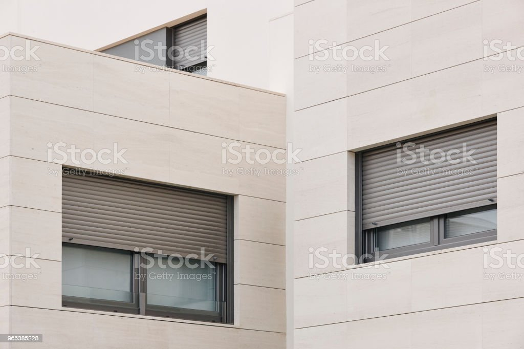 New building exterior facade with tiles. Construction. Buy royalty-free stock photo