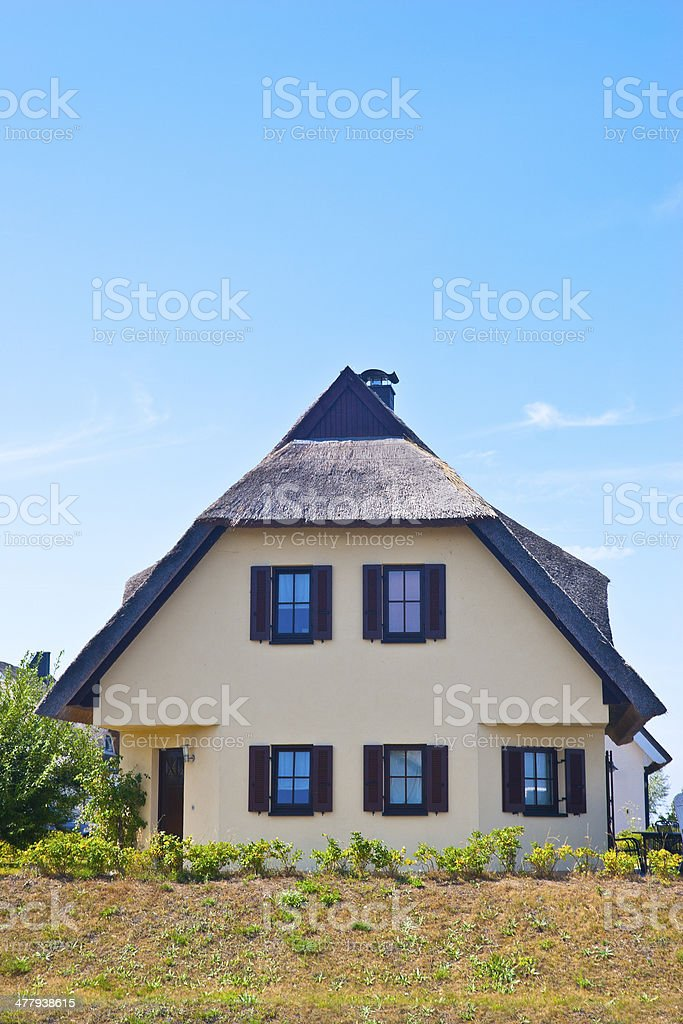 New built house with thatched roof royalty-free stock photo