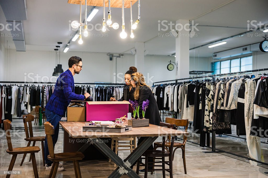 New Business clothing store, team at work on new arrivals stock photo