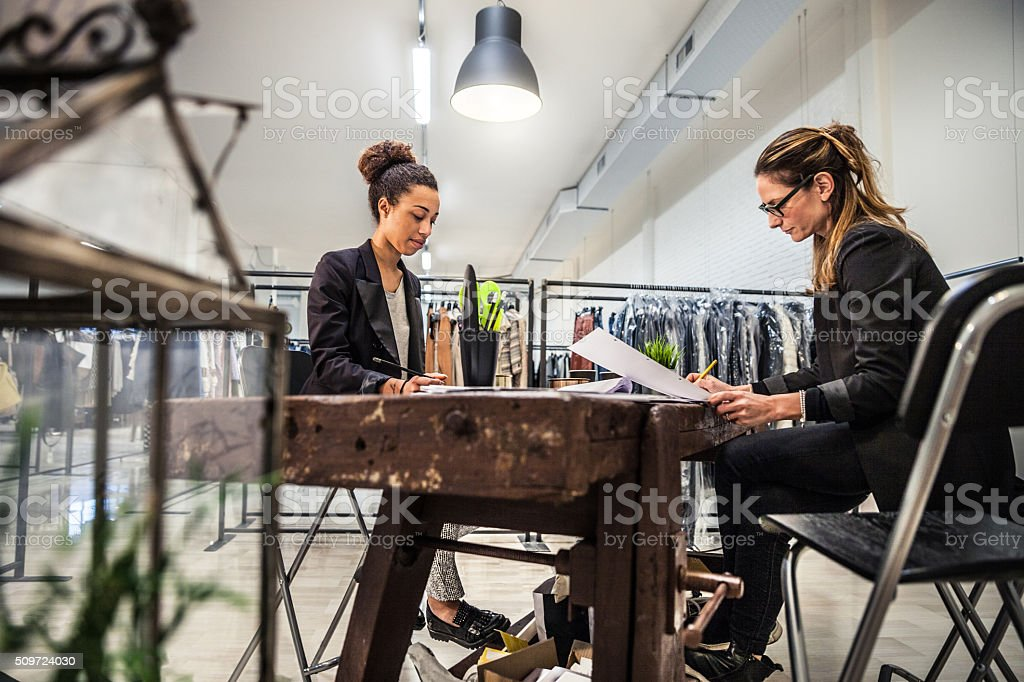New Business clothing store, women at work on contracts stock photo