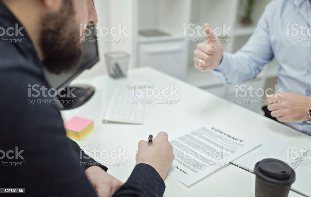 New business worker singing contract stock photo