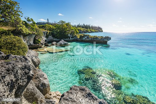 Maré Island, view over turquoise water at Tadine Bay, south-west coast of Maré Island with beautiful natural rocky lagoon and coral reef to the horizon under sunny blue summer sky Tadine Bay, Mare Island, Loyalty Islands, New Caledonia, Pacific Ocean Islands.