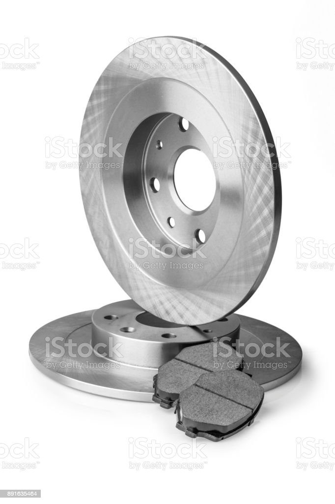 New car brake disc and brake linings on white background stock photo