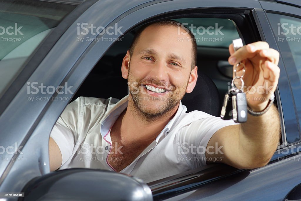 New car owner smiling into camera stock photo