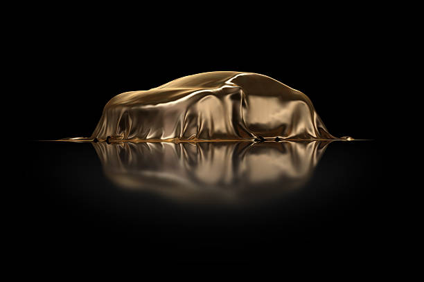 New car Presentation High resolution 3D Render of an new concept car under a golden envelope in black studio. car show stock pictures, royalty-free photos & images