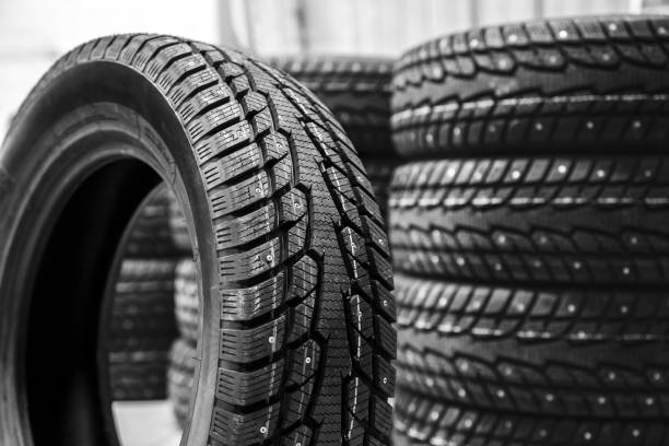 new car tire compared to other tires stock photo