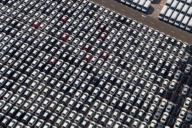 New cars and vans parked stock photo