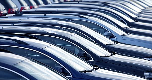 New cars in a row at dealership stock photo