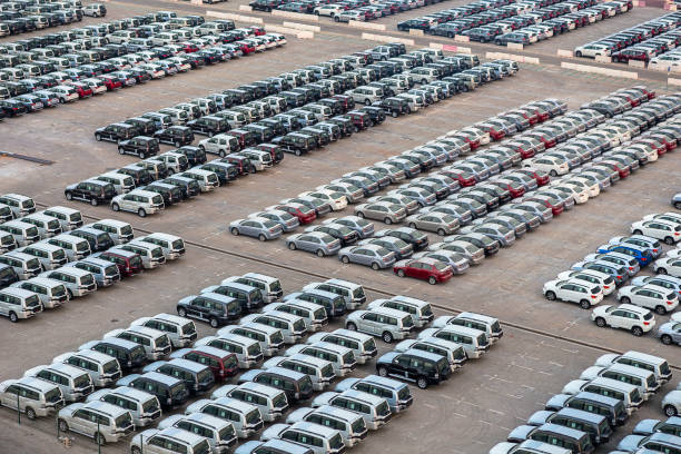 New cars in rows stored at port Rashid in Dubai, UAE
