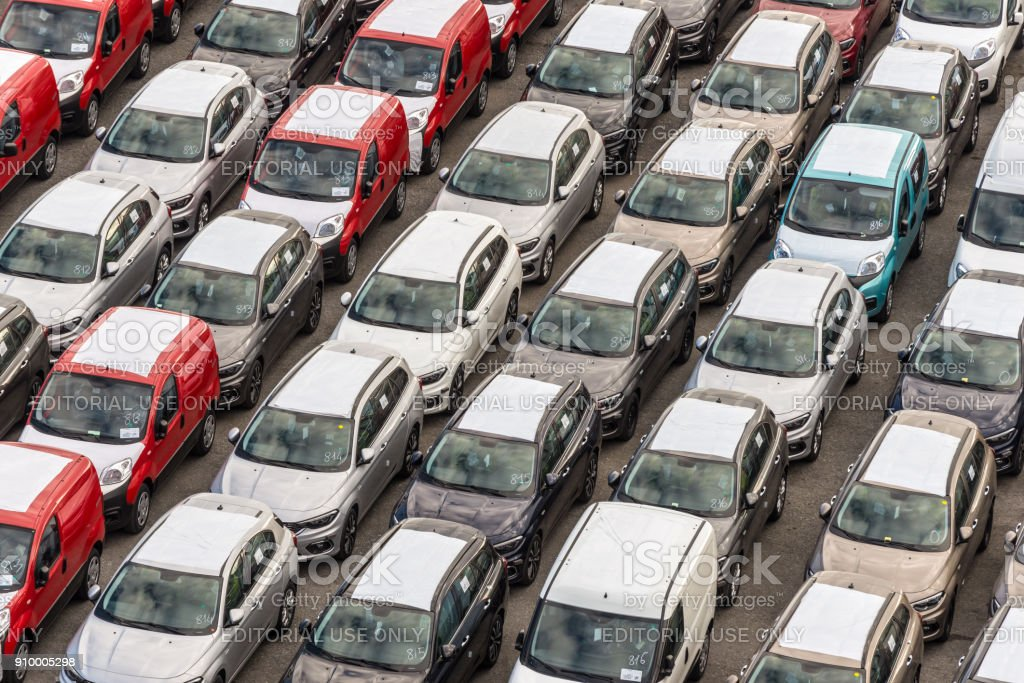New cars ready to ship in the port of Savona, Italy stock photo