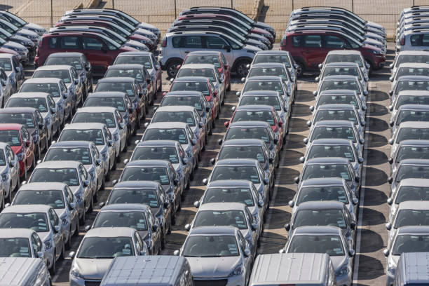 New cars standing in a row on parking lot stock photo