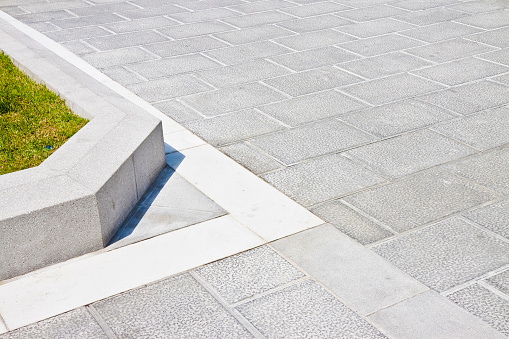 New carved paving made with grey stone blocks in an italian pedestrian zone