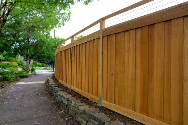 new cedar wood fence around house backyard landscaping - fence stock photos and pictures